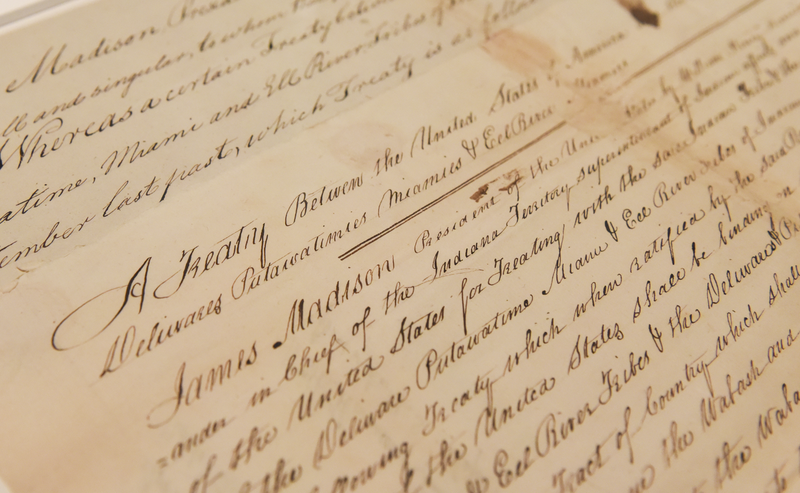 A close up of the the opening words of the Treaty of Fort Wayne, 1809. The treaty is handwritten in beautiful script on parchment.