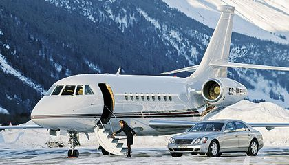 A Dassault Falcon 2000, a Maybach luxury auto, and freshly swept stairs: NetJets set up this publicity shot in Switzerland, but for fractional jet owners, such fantasy is the reality.