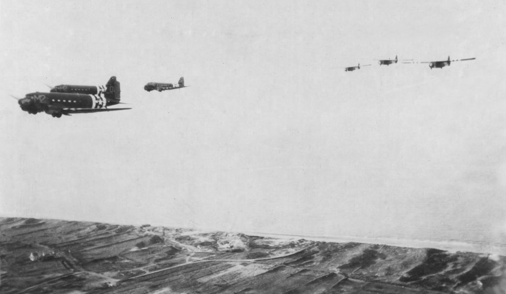 Three Douglas C-47s tow three troop-carrying gliders across the English Channel on D-Day morning, June 6, 1944. Earlier, during the night, 800 C-47s had crossed the channel, led by <i>That's All, Brother. </i>In the vanguard of the invasion, those transports brought 13,000 paratroopers to France.