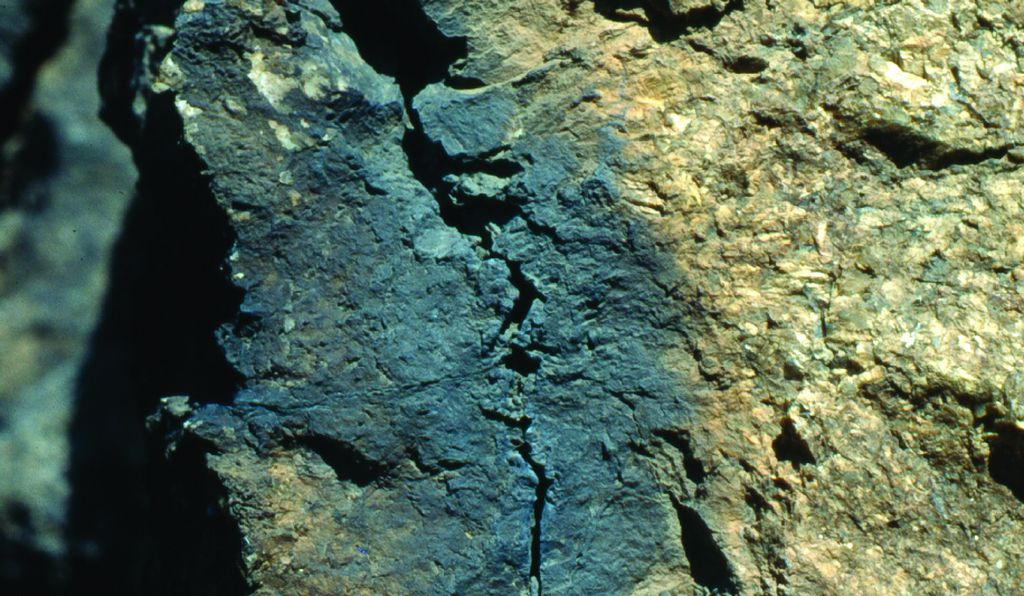 The fulgurite on this rock resembles a dark stain. Via PennNews