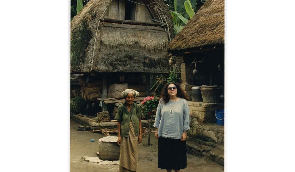 On the island of Lombok in Indonesia, Dunham poses with a villager in an image that was included in her book <em>Surviving Against the Odds,</em> which she dedicated to