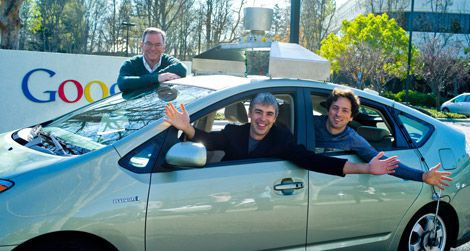 Google founders Eric Schmidt, Sergey Brin and Larry Page in their company's driverless car