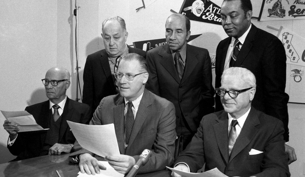 Commissioner Bowie Kuhn (front row, center) meets with the new committee established to nominate Negro League players to the Hall of Fame at his office on February 4, 1971.  Among the members is sportswriter Sam Lacy (back, center).