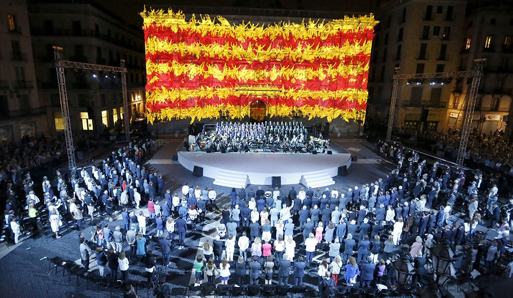 The Catalan flag is seen on the facade of the Palau de la Generalitat during a ceremony to mark