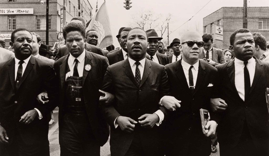 At the conclusion of the march from Selma to Montgomery on March 25, 1965, civil rights leaders linked arms (from left: Ralph Abernathy, James Forman, Martin Luther King, Jr., Jesse L. Douglas and John Lewis).
