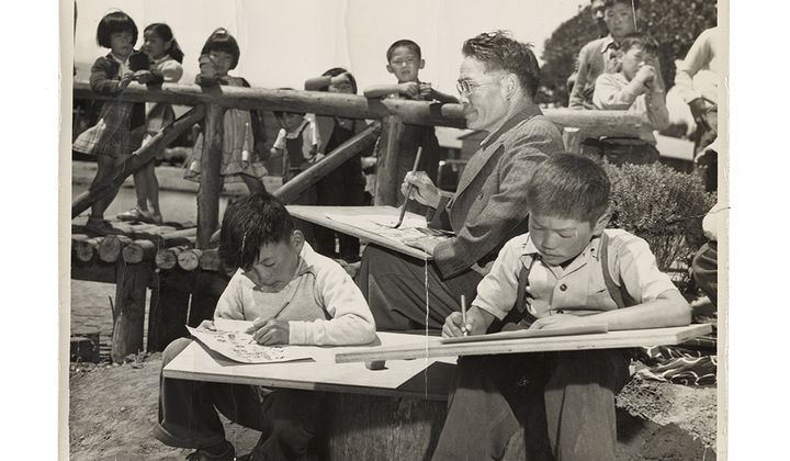 Photograph of Chiura Obata teaching a children's art class at Tanforan Art School, 1942 / unidentified photographer. Chiura Obata papers. Archives of American Art, Smithsonian Institution.