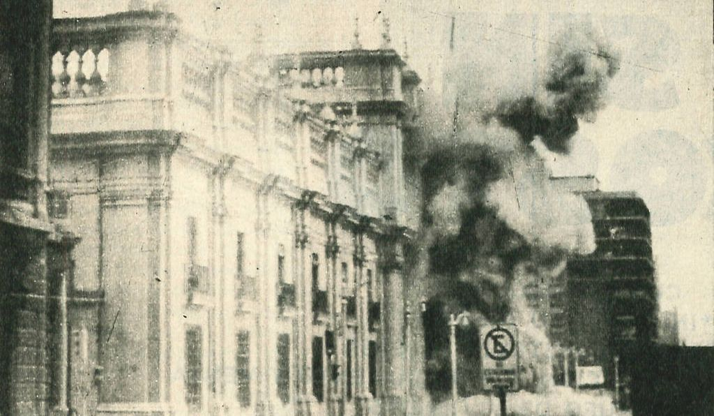 From the window of my third-floor apartment, I watched Hawker Hunter jet fighters fire missiles at the downtown area, where the presidential palace, La Moneda (above September 11, 1973), stood.