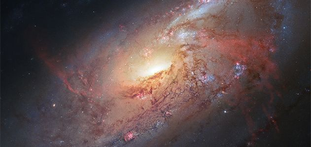 Galaxy M106 as captured by the Hubble Space Telescope.