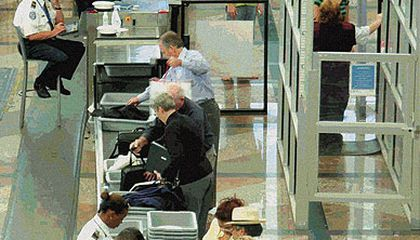 Right of Passage: In contrast to the early days of commercial airline travel, today, airport security officers screen passengers and their carry-on baggage in an effort to prevent attacks.