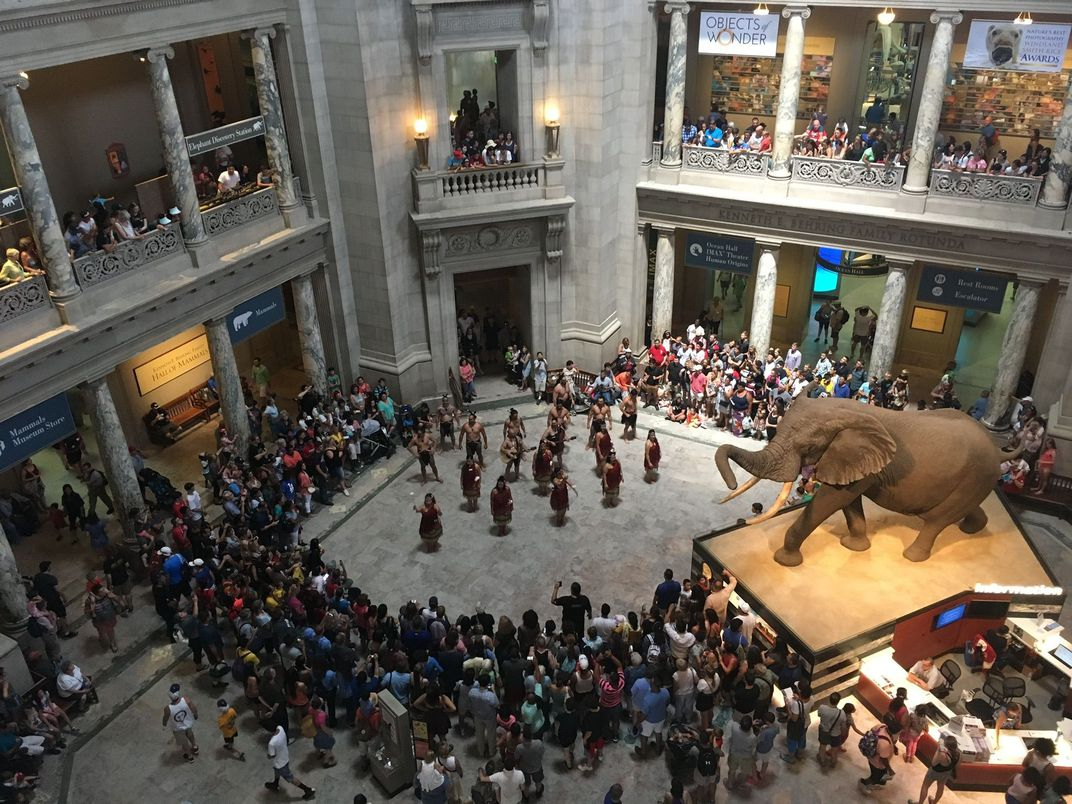 A crowd of people in the Rotunda at the National Museum of Natural History.