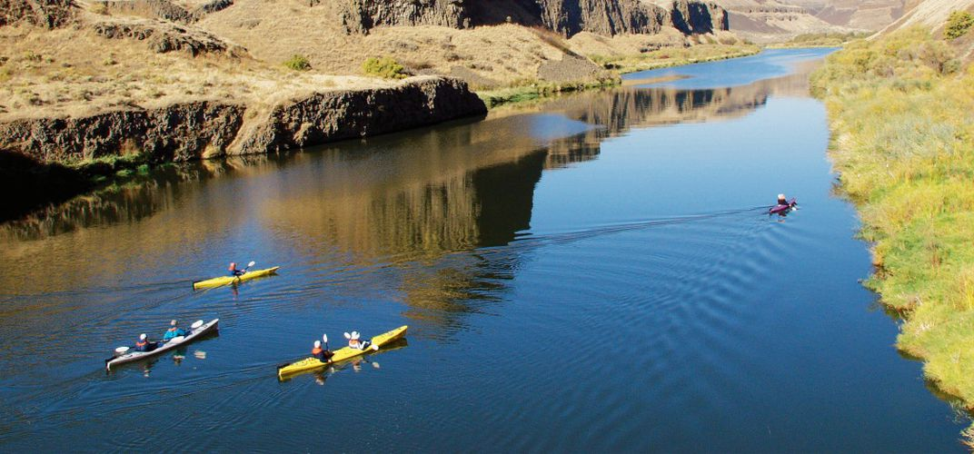 Kayakers on the Columbia River. Credit: Ralph Lee Hopkins
