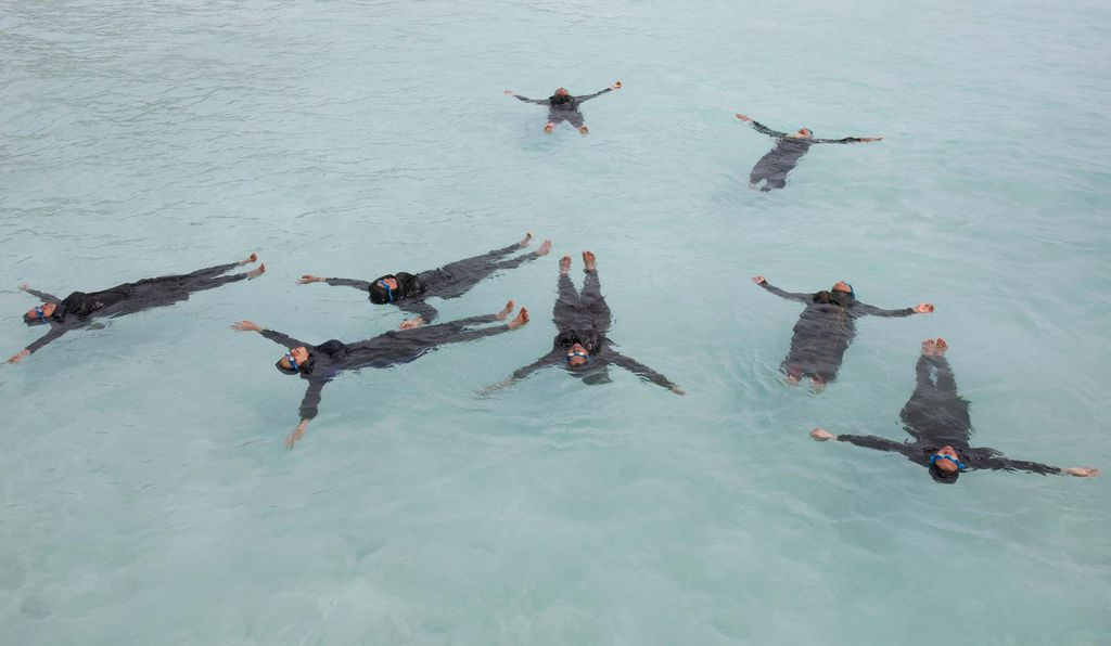 Maldivian mothers practice floating on their backs in the Soneva Learn-To-Swim program on the island of Eydhafushi.
