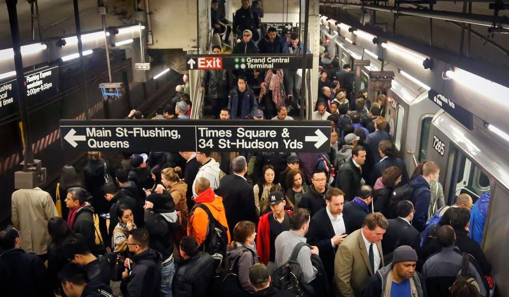 Commuters crowd a Grand Central subway station