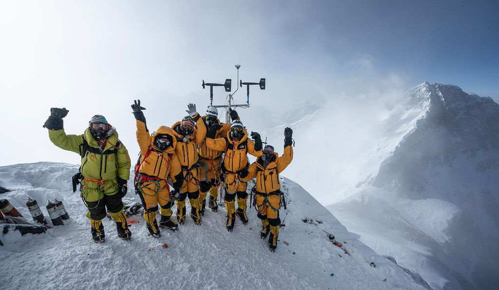 At 8,430 meters above sea level, the high-altitude expedition team celebrates after setting up the world's highest operating automated weather station during the National Geographic and Rolex Perpetual Planet Everest Expedition. For more info on the expedition, go to <a href='https://www.nationalgeographic.com/environment/perpetual-planet/' target='_blank'>www.NatGeo.com/Everest</a>.