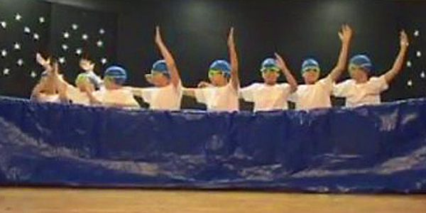 5th grade boys perform synchronized swimming skit