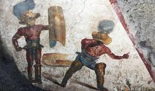 Bloody Gladiator Fresco Unearthed in Pompeii