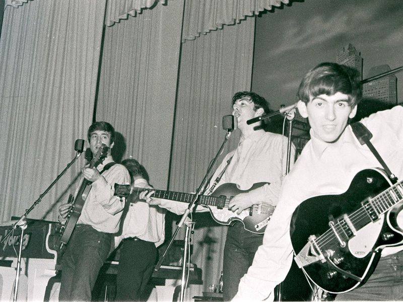 John Lennon, Paul McCartney and George Harrison perform at the Star-Club in Hamburg, Germany, in May 1962