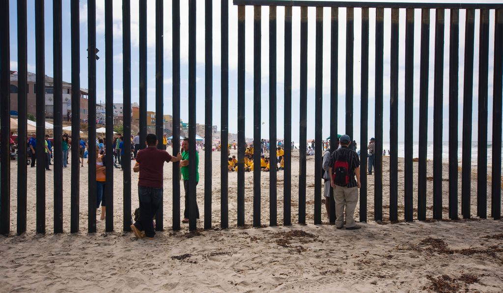 Some 650 miles of disparate segments of fence stand along the almost 2,000-mile border between the U.S. and Mexico. Many segments, like the one pictured above, still allow some communication across the border.
