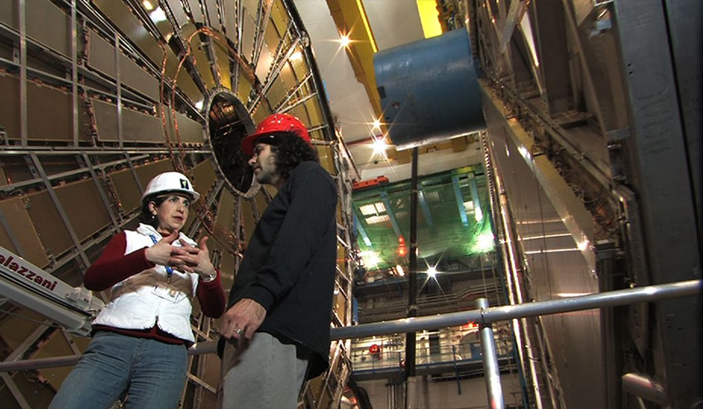 ATLAS spokeswoman Fabiola Gianotti chats with David Kaplan at CERN.