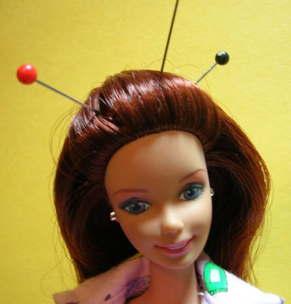 Acupuncture Barbie suffers from chronic pain.