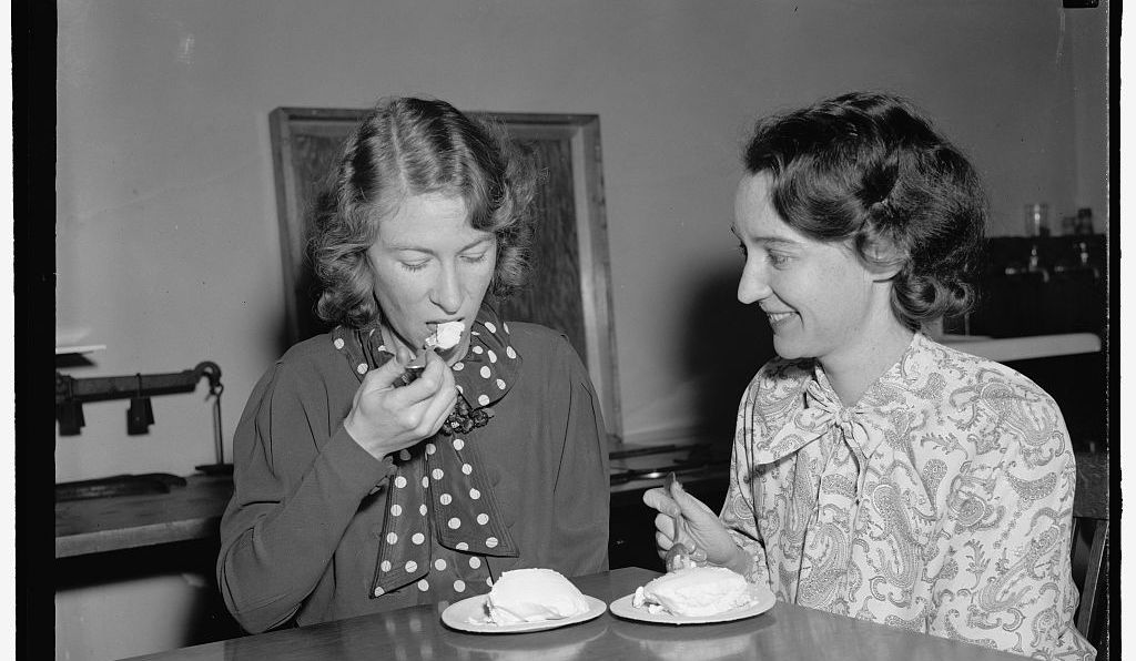 Two USDA employees try ice cream made from salt-preserved cream, 1939.