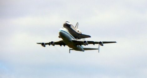Space Shuttle Discovery flies over Washington, DC.