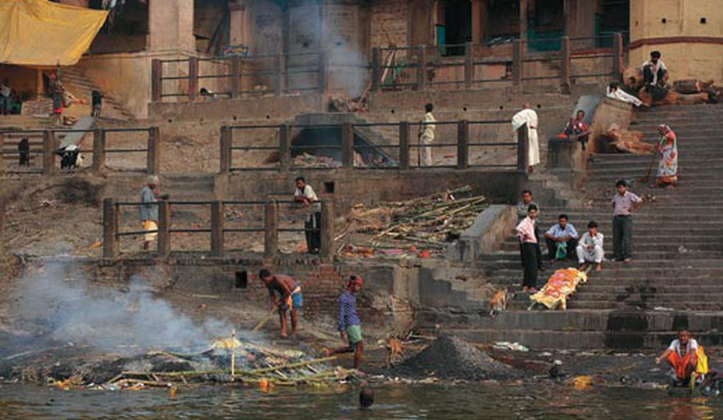 In Varanasi, India's holiest city (where pilgrims, right, descend to the river on ghats, or steps), millions of Hindus converge each year to bathe in the sacred waters and cremate their dead. Here, sewage is the major contaminant: a proposed $60 million treatment plant has yet to be funded.