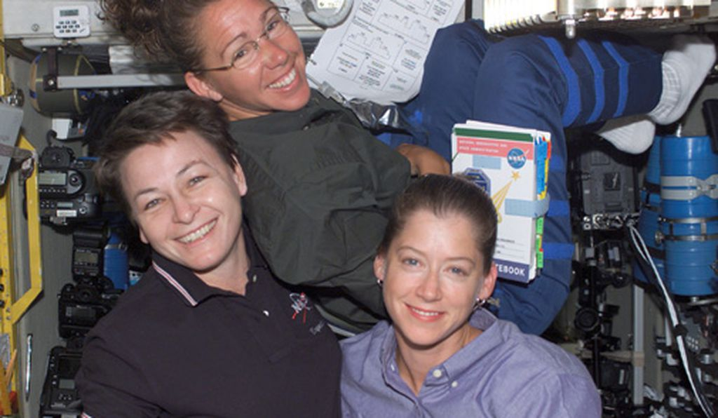 Left to right: Peggy Whitson, Sandra Magnus, and Pam Melroy onboard the International Space Station, October 2002.