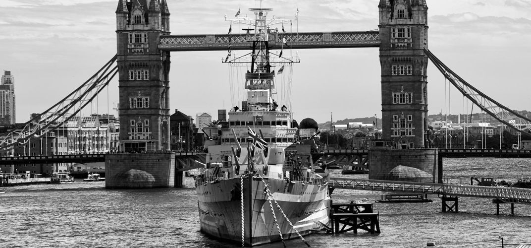 British cruiser HMS <i>Belfast</i> at London's Tower Bridge