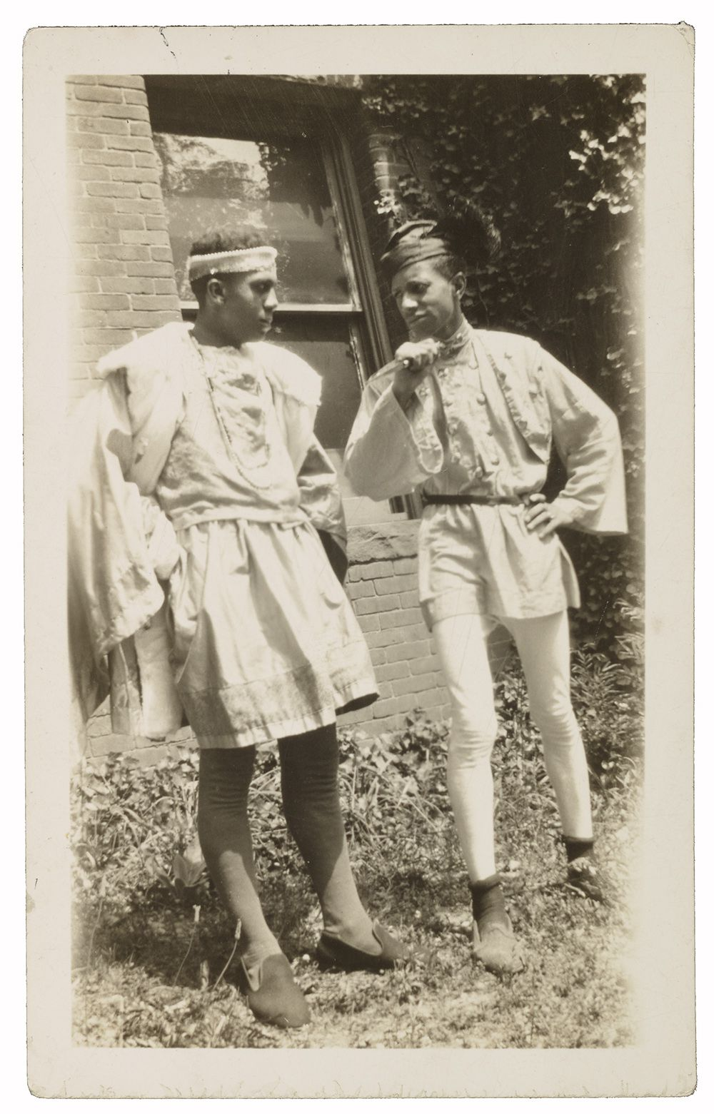 Two Howard University students wearing Renaissance-style costumes designed by Alma Thomas.