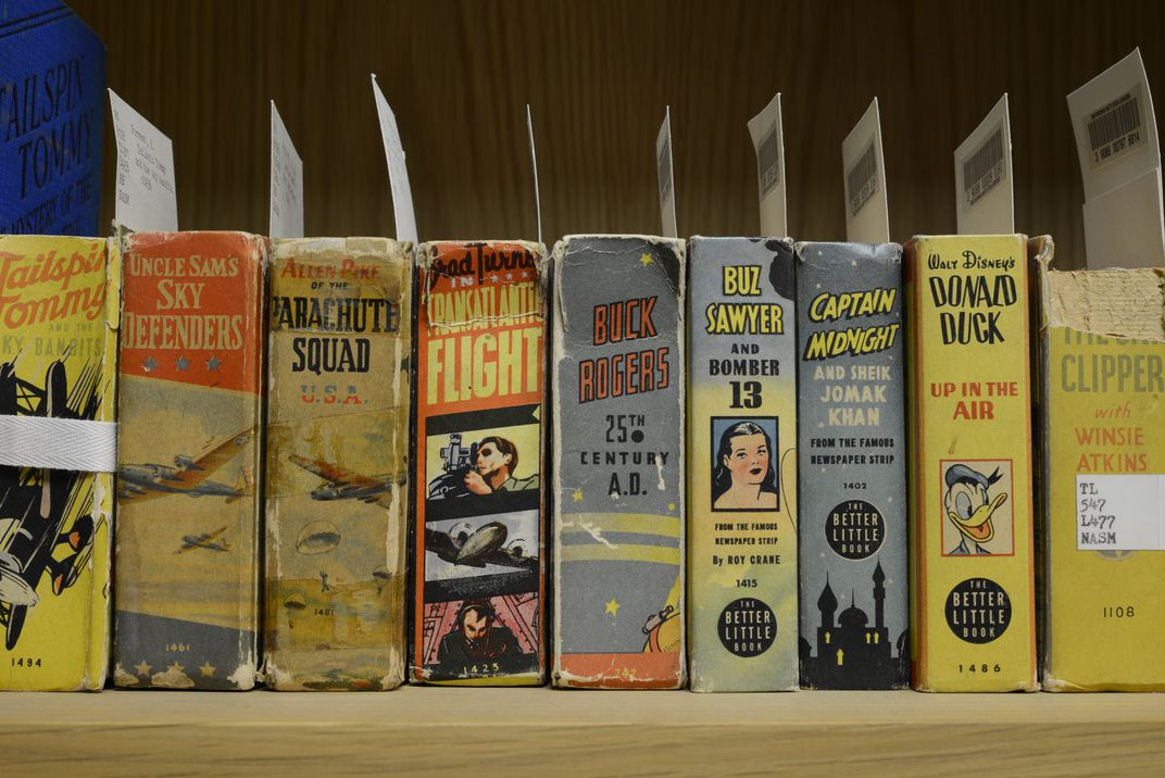 Photograph of juvenile aviation book spines on library shelf.