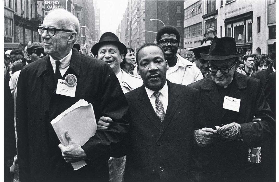 Dr. Martin Luther King, Jr. marches from Central Park to the United Nations Plaza in a demonstration against the Vietnam War with thousands of protesters, ...