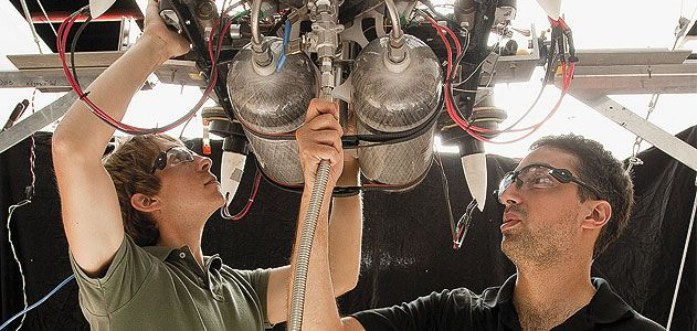 Draper Lab team members Bobby Cohanim (in black shirt) and Eph Lanford check fittings and connections on TALARIS before running a test.