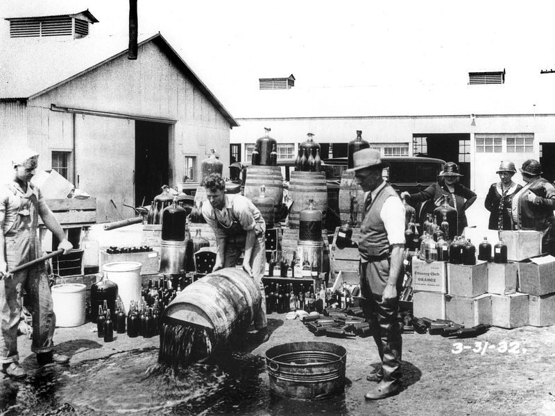 Orange_County_Sheriff's_deputies_dumping_illegal_booze,_Santa_Ana,_3-31-1932.jpg