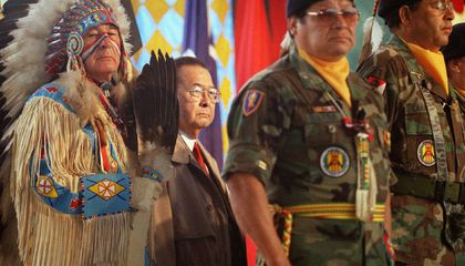 Dressed in ceremonial regalia, Senator Ben Nighthorse Campbell (Northern Cheyenne), a veteran of the Korean War, stands with World War II veteran Senator Daniel K. Inouye  and Native American veterans  of the Vietnam War during the opening of the National Museum of the American Indian on the National Mall.  September 21, 2004, Washington, D.C. (Mario Tama/ AFP for the National Museum of the American Indian, Smithsonian)