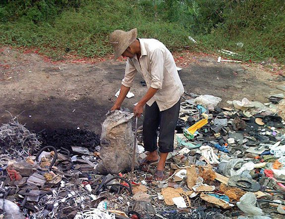 A man sorts through rubbish in Guiyu, the world's largest center for electronic waste.