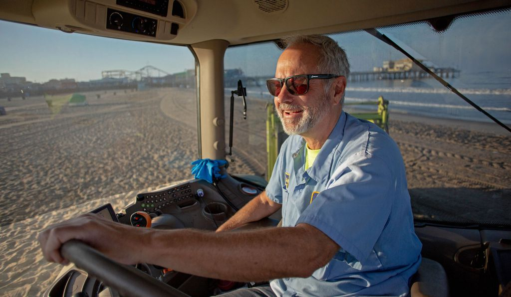 Gavin Andrus drives a John Deere tractor across his section of the 5.6-kilometer-long Santa Monica State Beach, collecting everything from condoms to diapers.