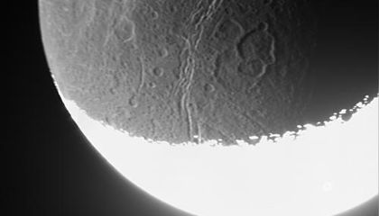 Cassini captures the dim light from a distant moon.