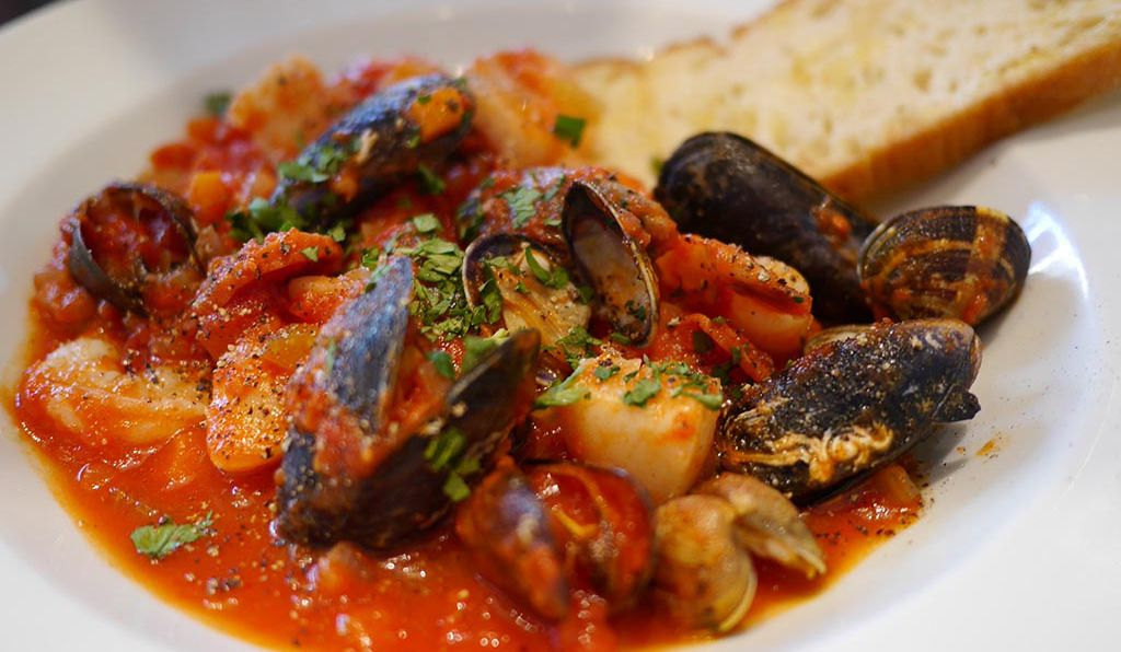 In Italy, <em>zuppa di pesci</em> typically combines fish, mussels, shrimp, scallops and other underwater delicacies.