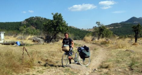 The author runs on empty as he pushes his bike over rough terrain in the Murat Mountains.