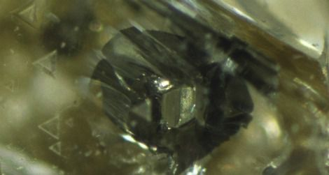 A hexagonal grain of iron sulfide in a diamond may be a flaw for jewelers, but it's useful data for scientists