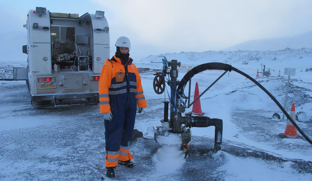 Juerg Matter stands next to the injection well at the CarbFix pilot project.