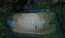boy under a bridge