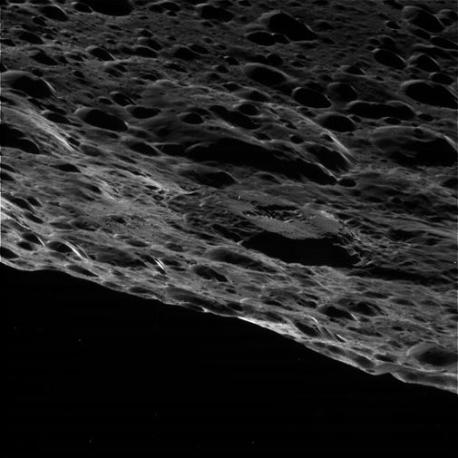 A close fly-by of Saturn's two-faced moon.