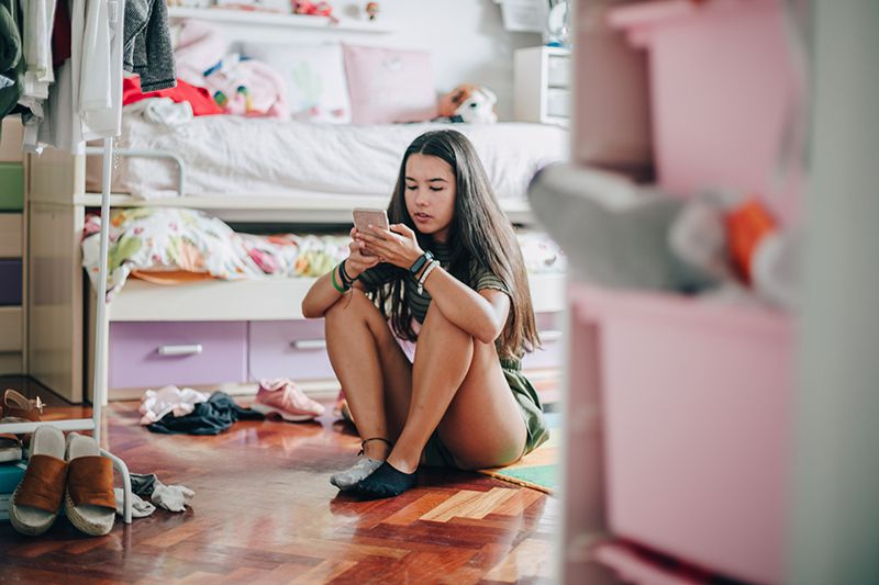 Teen girl on her mobile device-main.jpg