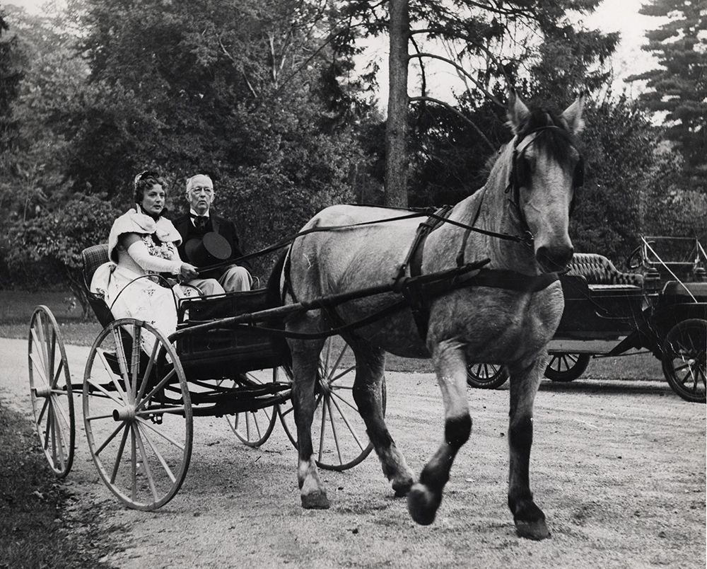 Photograph of Charles Sheeler and his wife Musya arrving at a party in a carriage.
