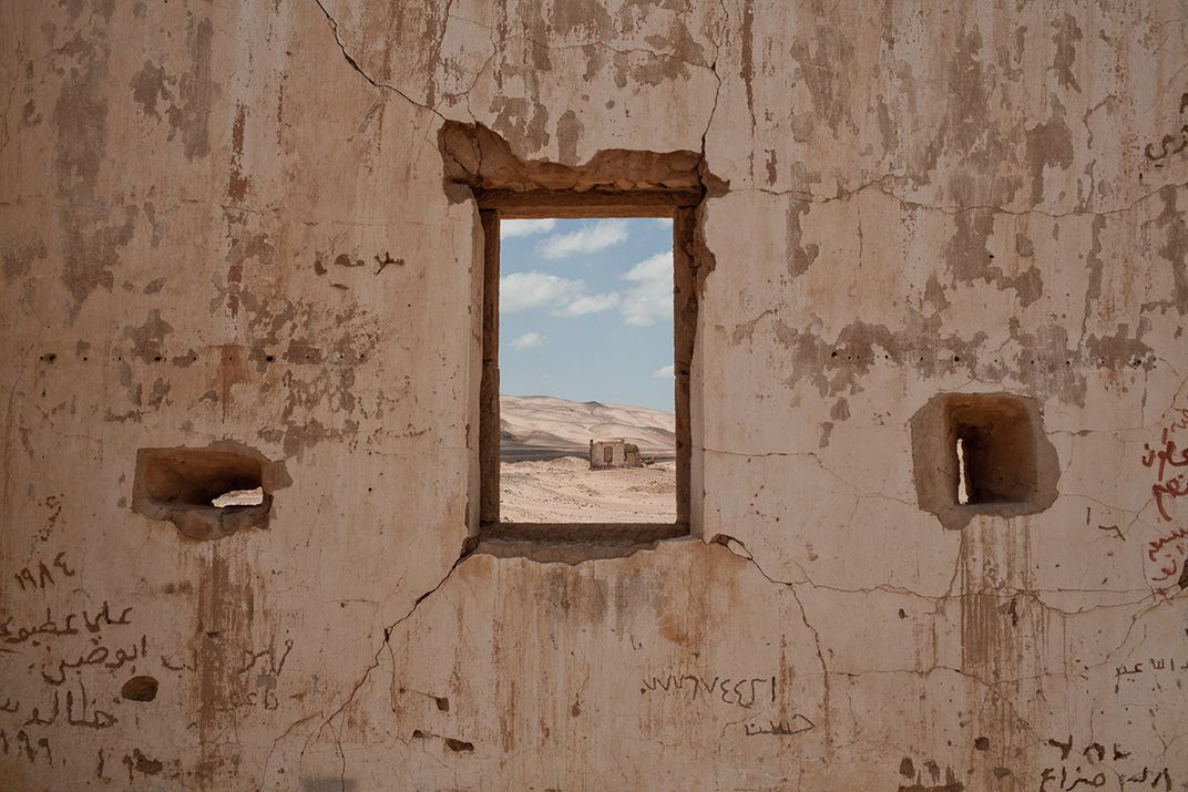 a window in what was once a turkish fort overlooks a desolate desert landscape near the hejaz railway ivor prickett panos pictures