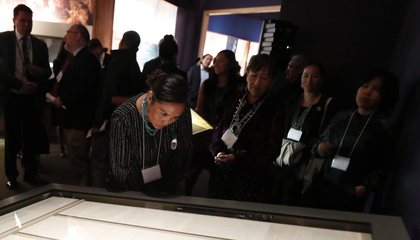 Representatives of the Navajo Nation read the original text of the Naaltsoos Sání, or Navajo Treaty of 1868, after its unveiling in the exhibition