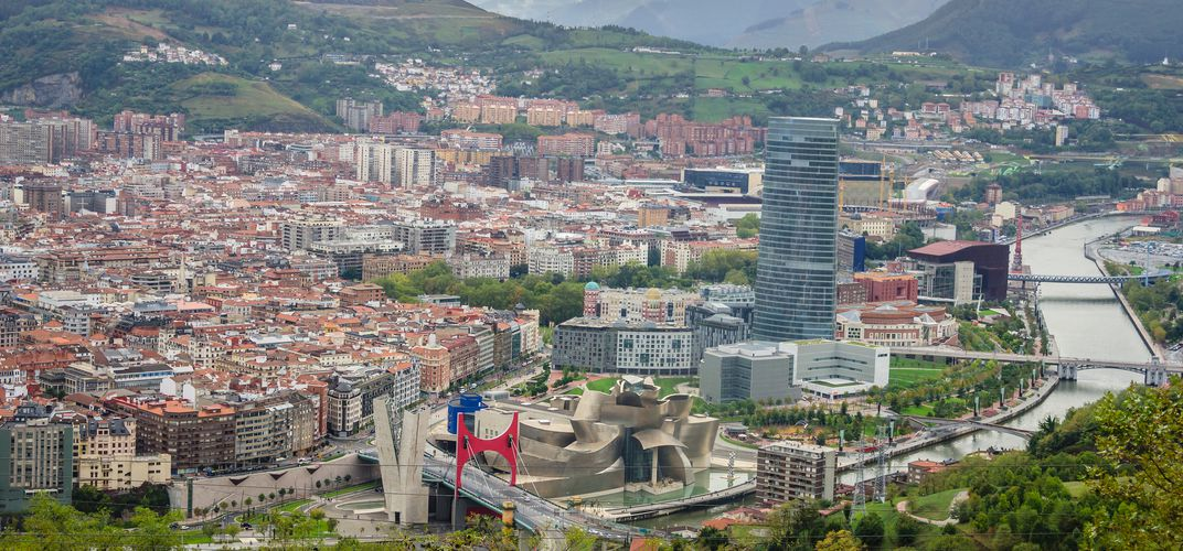The city of Bilbao, with the Guggenheim Museum, set amid the Basque countryside