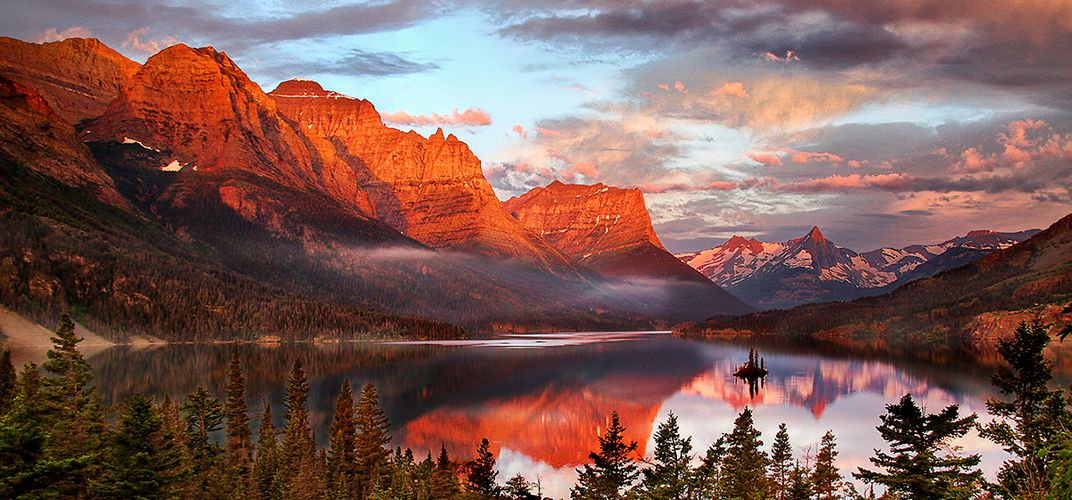 Vivid sunset over Glacier National Park.  Credit: Tom Crouse